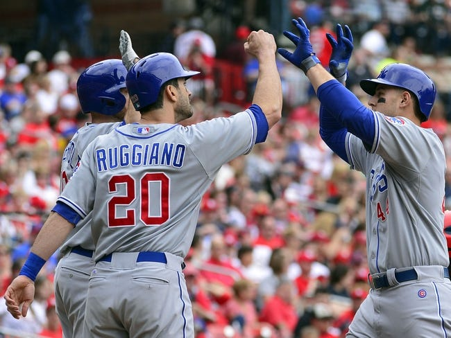 Apr 13, 2014; St. Louis, MO, USA; Chicago Cubs first baseman Anthony Rizzo (44) celebrates with teammates after hitting a two home run against the St. Louis Cardinals at Busch Stadium. Mandatory Credit: Scott Rovak-USA TODAY Sports
