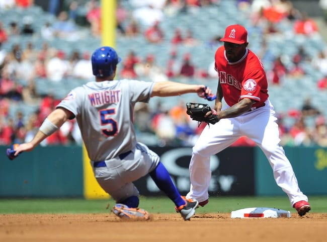 April 13, 2014; Anaheim, CA, USA; New York Mets third baseman David Wright (5) is caught stealing second in the first inning against the tag of Los Angeles Angels second baseman Howie Kendrick (47) at Angel Stadium of Anaheim. Mandatory Credit: Gary A. Vasquez-USA TODAY Sports