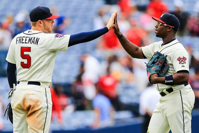 Apr 13, 2014; Atlanta, GA, USA; Atlanta Braves first baseman Freddie Freeman (5) celebrates with left fielder Justin Upton (8) after defeating the Washington Nationals 10-2 at Turner Field. Mandatory Credit: Daniel Shirey-USA TODAY Sports