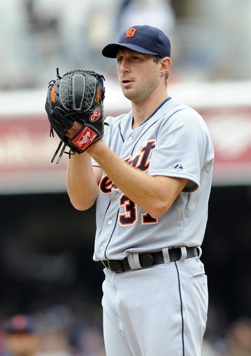 Apr 13, 2014; San Diego, CA, USA; Detroit Tigers starting pitcher Max Scherzer (37) looks in for a sign during the first inning against the San Diego Padres at Petco Park. Mandatory Credit: Christopher Hanewinckel-USA TODAY Sports