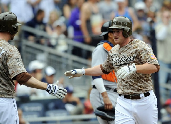 Apr 13, 2014; San Diego, CA, USA; San Diego Padres second baseman Jedd Gyorko (9) is congratulated by third baseman Chase Headley (7) after a home run during the second inning against the Detroit Tigers at Petco Park. Mandatory Credit: Christopher Hanewinckel-USA TODAY Sports