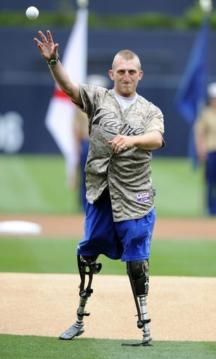 Apr 13, 2014; San Diego, CA, USA; USMC veteran Rob Jones throws out the honorary first pitch on military opening day before the San Diego Padres game against the Detroit Tigers at Petco Park. Mandatory Credit: Christopher Hanewinckel-USA TODAY Sports