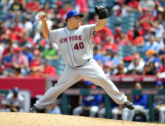 April 13, 2014; Anaheim, CA, USA; New York Mets starting pitcher Bartolo Colon (40) pitches the fourth inning against the Los Angeles Angels at Angel Stadium of Anaheim. Mandatory Credit: Gary A. Vasquez-USA TODAY Sports