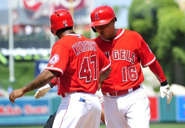 April 13, 2014; Anaheim, CA, USA; Los Angeles Angels catcher Hank Conger (16) celebrates with second baseman Howie Kendrick (47) after hitting a two run home run in the fifth inning against the New York Mets at Angel Stadium of Anaheim. Mandatory Credit: Gary A. Vasquez-USA TODAY Sports