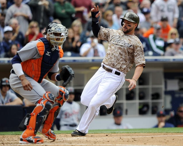 Apr 13, 2014; San Diego, CA, USA; San Diego Padres first baseman Yonder Alonso (23) scores ahead of the play by Detroit Tigers catcher Victor Martinez (41) during the fourth inning at Petco Park. Mandatory Credit: Christopher Hanewinckel-USA TODAY Sports
