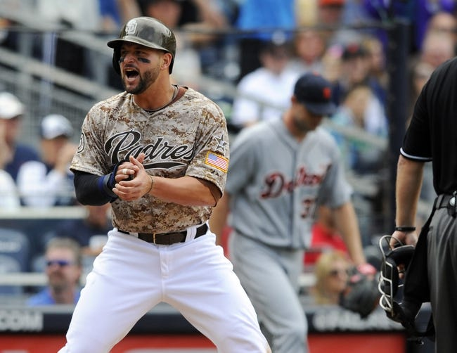 Apr 13, 2014; San Diego, CA, USA; San Diego Padres first baseman Yonder Alonso (23) celebrates after scoring during the fourth inning against the Detroit Tigers at Petco Park. Mandatory Credit: Christopher Hanewinckel-USA TODAY Sports