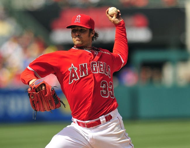 April 13, 2014; Anaheim, CA, USA; Los Angeles Angels starting pitcher C.J. Wilson (33) pitches the seventh inning against the New York Mets at Angel Stadium of Anaheim. Mandatory Credit: Gary A. Vasquez-USA TODAY Sports