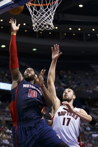 Apr 13, 2014; Auburn Hills, MI, USA; Detroit Pistons forward Greg Monroe (10) shoots on Toronto Raptors center Jonas Valanciunas (17) in the third quarter at The Palace of Auburn Hills. Toronto won 116-107. Mandatory Credit: Rick Osentoski-USA TODAY Sports