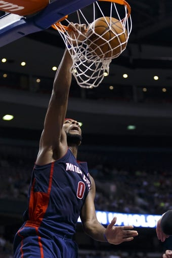 Apr 13, 2014; Auburn Hills, MI, USA; Detroit Pistons center Andre Drummond (0) dunks in the third quarter against the Toronto Raptors at The Palace of Auburn Hills. Toronto won 116-107. Mandatory Credit: Rick Osentoski-USA TODAY Sports