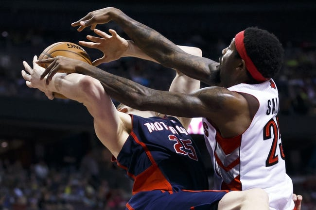 Apr 13, 2014; Auburn Hills, MI, USA; Detroit Pistons forward Kyle Singler (25) is fouled by Toronto Raptors forward John Salmons (25) in the third quarter at The Palace of Auburn Hills. Toronto won 116-107. Mandatory Credit: Rick Osentoski-USA TODAY Sports