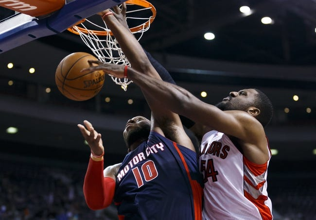 Apr 13, 2014; Auburn Hills, MI, USA; Toronto Raptors forward Patrick Patterson (54) blocks a shot by Detroit Pistons forward Greg Monroe (10) in the fourth quarter at The Palace of Auburn Hills. Toronto won 116-107. Mandatory Credit: Rick Osentoski-USA TODAY Sports