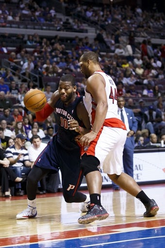 Apr 13, 2014; Auburn Hills, MI, USA; Detroit Pistons forward Greg Monroe (10) dribbles around Toronto Raptors forward Chuck Hayes (44) in the fourth quarter at The Palace of Auburn Hills. Toronto won 116-107. Mandatory Credit: Rick Osentoski-USA TODAY Sports