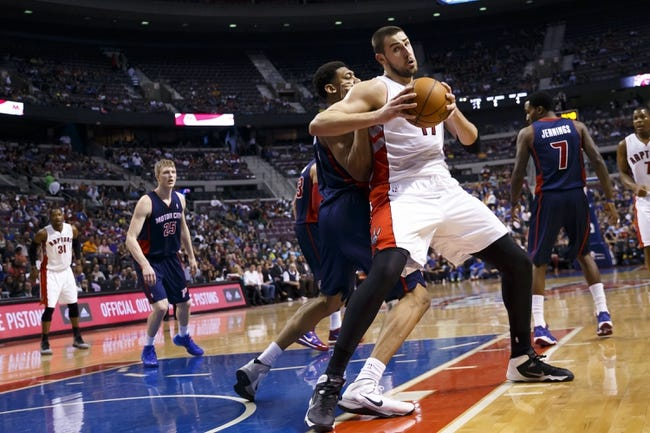 Apr 13, 2014; Auburn Hills, MI, USA; Toronto Raptors center Jonas Valanciunas (17) is defended by Detroit Pistons guard Kentavious Caldwell-Pope (5) in the first quarter at The Palace of Auburn Hills. Mandatory Credit: Rick Osentoski-USA TODAY Sports