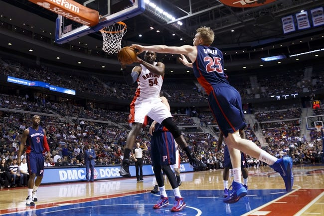 Apr 13, 2014; Auburn Hills, MI, USA; Toronto Raptors forward Patrick Patterson (54) grabs the rebound on Detroit Pistons forward Kyle Singler (25) in the first quarter at The Palace of Auburn Hills. Mandatory Credit: Rick Osentoski-USA TODAY Sports