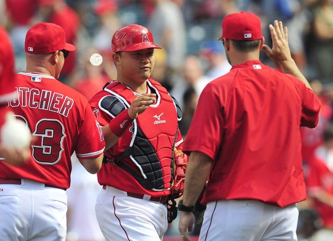 April 13, 2014; Anaheim, CA, USA; Los Angeles Angels catcher Hank Conger (16) celebrates the 14-2 victory against the New York Mets at Angel Stadium of Anaheim. Mandatory Credit: Gary A. Vasquez-USA TODAY Sports