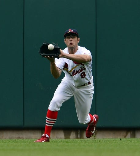 Apr 13, 2014; St. Louis, MO, USA; St. Louis Cardinals center fielder Peter Bourjos (8) makes a catch against the Chicago Cubs at Busch Stadium. The Cardinals won 6-4. Mandatory Credit: Scott Rovak-USA TODAY Sports