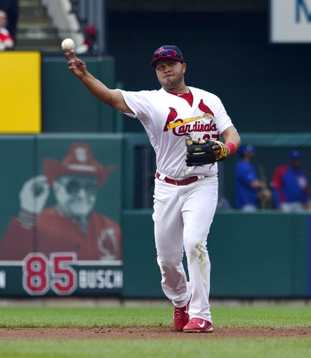 Apr 13, 2014; St. Louis, MO, USA; St. Louis Cardinals shortstop Jhonny Peralta (27) throws out a Chicago Cubs base runner at Busch Stadium. The Cardinals defeated the Cubs 6-4. Mandatory Credit: Scott Rovak-USA TODAY Sports
