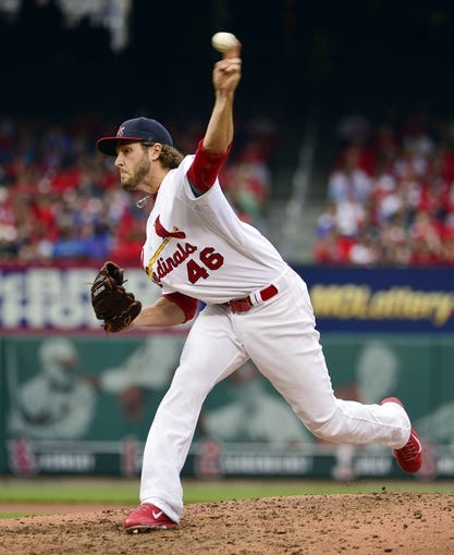 Apr 13, 2014; St. Louis, MO, USA; St. Louis Cardinals relief pitcher Kevin Siegrist (46) delivers a pitch against the Chicago Cubs at Busch Stadium. The Cardinals defeated the Cubs 6-4. Mandatory Credit: Scott Rovak-USA TODAY Sports