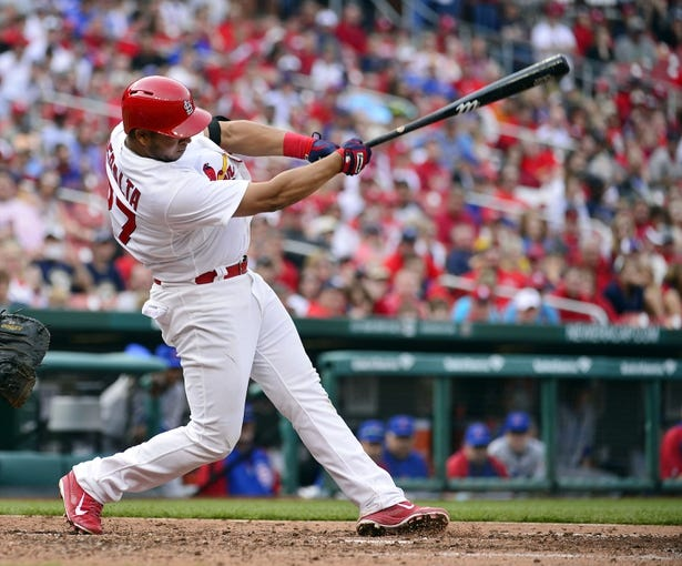 Apr 13, 2014; St. Louis, MO, USA; St. Louis Cardinals shortstop Jhonny Peralta (27) connects for an RBI double against the Chicago Cubs at Busch Stadium. The Cardinals defeated the Cubs 6-4. Mandatory Credit: Scott Rovak-USA TODAY Sports