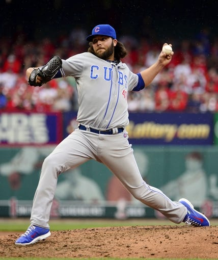 Apr 13, 2014; St. Louis, MO, USA; Chicago Cubs relief pitcher James Russell (40) delivers a pitch against the St. Louis Cardinals at Busch Stadium. The Cardinals defeated the Cubs 6-4. Mandatory Credit: Scott Rovak-USA TODAY Sports