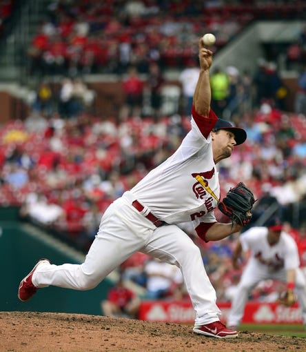 Apr 13, 2014; St. Louis, MO, USA; St. Louis Cardinals relief pitcher Trevor Rosenthal (26) delivers a pitch against the Chicago Cubs at Busch Stadium. The Cardinals defeated the Cubs 6-4. Mandatory Credit: Scott Rovak-USA TODAY Sports