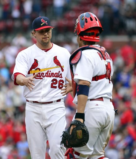 Apr 13, 2014; St. Louis, MO, USA; St. Louis Cardinals relief pitcher Trevor Rosenthal (26) and catcher Yadier Molina (4) congratulate each other after the game against the Chicago Cubs at Busch Stadium. The Cardinals defeated the Cubs 6-4. Mandatory Credit: Scott Rovak-USA TODAY Sports