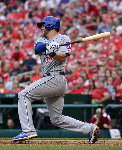 Apr 13, 2014; St. Louis, MO, USA; Chicago Cubs first baseman Mike Olt (30) hits an RBI single against the St. Louis Cardinals at Busch Stadium. The Cardinals defeated the Cubs 6-4. Mandatory Credit: Scott Rovak-USA TODAY Sports