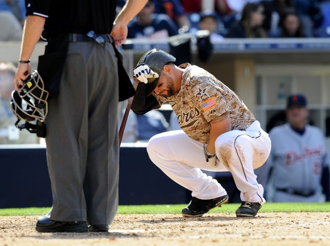 Apr 13, 2014; San Diego, CA, USA; San Diego Padres first baseman Yonder Alonso (23) reacts after being hit by his own foul ball during the eighth inning against the Detroit Tigers at Petco Park. Mandatory Credit: Christopher Hanewinckel-USA TODAY Sports
