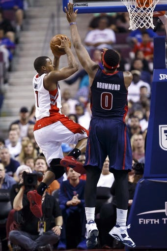 Apr 13, 2014; Auburn Hills, MI, USA; Toronto Raptors guard Kyle Lowry (7) shoots on Detroit Pistons center Andre Drummond (0) in the fourth quarter at The Palace of Auburn Hills. Mandatory Credit: Rick Osentoski-USA TODAY Sports