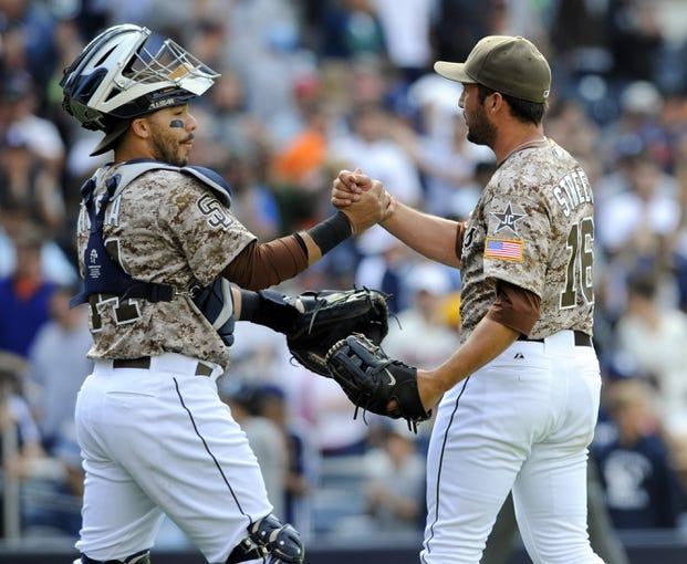 Apr 13, 2014; San Diego, CA, USA; San Diego Padres relief pitcher Huston Street (16) celebrates with catcher Rene Rivera (44) after a win against the Detroit Tigers at Petco Park. The Padres won 5-1. Mandatory Credit: Christopher Hanewinckel-USA TODAY Sports