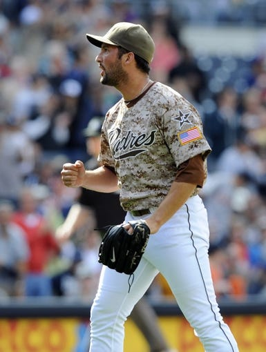 Apr 13, 2014; San Diego, CA, USA; San Diego Padres relief pitcher Huston Street (16) pumps his fist after a win against the Detroit Tigers at Petco Park. The Padres won 5-1. Mandatory Credit: Christopher Hanewinckel-USA TODAY Sports