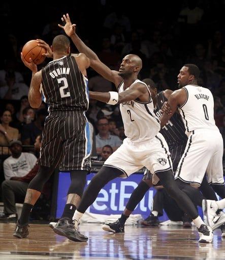Apr 13, 2014; Brooklyn, NY, USA; Brooklyn Nets forward Kevin Garnett (2) defends against Orlando Magic forward Kyle O   Quinn (2) in the second quarter at Barclays Center. Mandatory Credit: Nicole Sweet-USA TODAY Sports