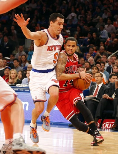 Apr 13, 2014; New York, NY, USA;  Chicago Bulls guard D.J. Augustin (14) drives to the basket during the first half against New York Knicks guard Pablo Prigioni (9) at Madison Square Garden. Mandatory Credit: Jim O'Connor-USA TODAY Sports