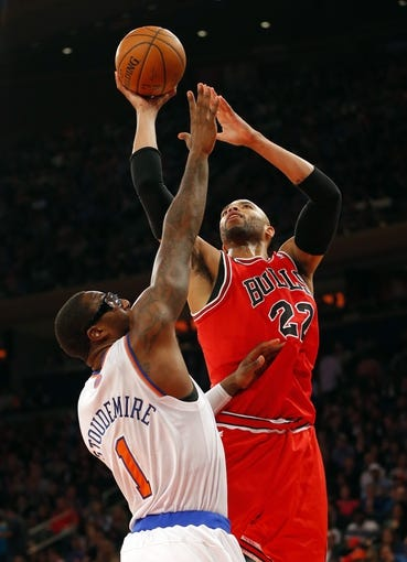 Apr 13, 2014; New York, NY, USA;  Chicago Bulls forward Taj Gibson (22) drives to the basket against New York Knicks forward Amar'e Stoudemire (1) during the first half at Madison Square Garden. Mandatory Credit: Jim O'Connor-USA TODAY Sports