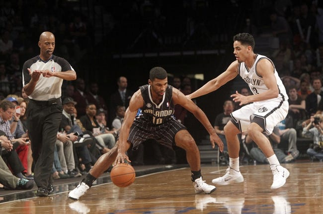Apr 13, 2014; Brooklyn, NY, USA; Brooklyn Nets guard Jorge Gutierrez (13) defends against Orlando Magic guard Ronnie Price (10) in the fourth quarter at Barclays Center. Nets win 97-88. Mandatory Credit: Nicole Sweet-USA TODAY Sports