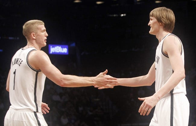 Apr 13, 2014; Brooklyn, NY, USA; Brooklyn Nets forward Mason Plumlee (1) and Brooklyn Nets forward Andrei Kirilenko (47) react against Orlando Magic in the fourth quarter at Barclays Center. Nets win 97-88. Mandatory Credit: Nicole Sweet-USA TODAY Sports