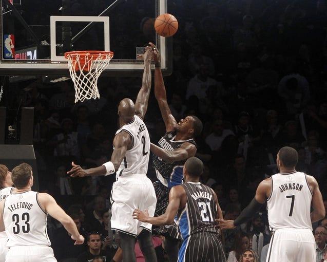 Apr 13, 2014; Brooklyn, NY, USA; Brooklyn Nets forward Kevin Garnett (2) blocks a shot against Orlando Magic center Dewayne Dedmon (3) in the fourth quarter at Barclays Center. Nets win 97-88. Mandatory Credit: Nicole Sweet-USA TODAY Sports
