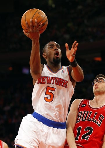 Apr 13, 2014; New York, NY, USA;  New York Knicks guard Tim Hardaway Jr. (5) drives to the basket during the second half against Chicago Bulls guard Kirk Hinrich (12) at Madison Square Garden. New York Knicks defeat the Chicago Bulls 100-89. Mandatory Credit: Jim O'Connor-USA TODAY Sports