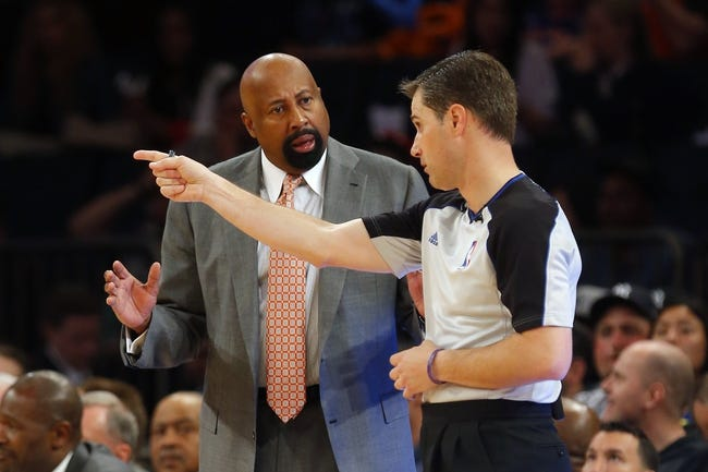 Apr 13, 2014; New York, NY, USA;  New York Knicks head coach Mike Woodson questions call with referee David Guthrie (16) during the second half at Madison Square Garden. New York Knicks defeat the Chicago Bulls 100-89. Mandatory Credit: Jim O'Connor-USA TODAY Sports