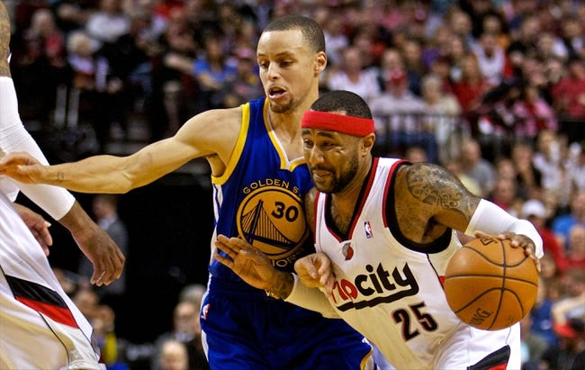 Apr 13, 2014; Portland, OR, USA; Portland Trail Blazers guard Mo Williams (25) drives past Golden State Warriors guard Stephen Curry (30) during the second quarter at the Moda Center. Mandatory Credit: Craig Mitchelldyer-USA TODAY Sports
