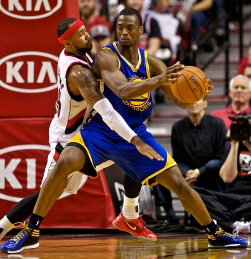 Apr 13, 2014; Portland, OR, USA; Golden State Warriors forward Harrison Barnes (40) posts up on Portland Trail Blazers guard Mo Williams (25) during the second quarter at the Moda Center. Mandatory Credit: Craig Mitchelldyer-USA TODAY Sports