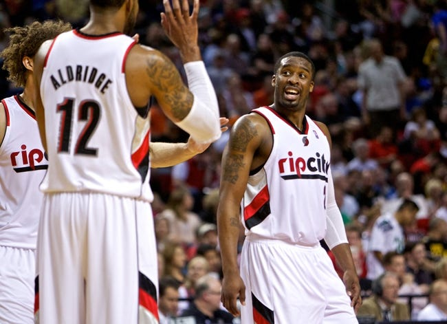 Apr 13, 2014; Portland, OR, USA; Portland Trail Blazers guard Wesley Matthews (2) reacts to forward LaMarcus Aldridge (12) during the second quarter against the Golden State Warriors at the Moda Center. Mandatory Credit: Craig Mitchelldyer-USA TODAY Sports