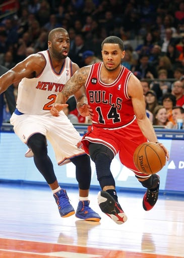 Apr 13, 2014; New York, NY, USA;  Chicago Bulls guard D.J. Augustin (14) drives to the basket against New York Knicks guard Raymond Felton (2) at Madison Square Garden. Mandatory Credit: Jim O'Connor-USA TODAY Sports
