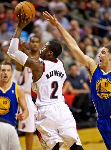 Apr 13, 2014; Portland, OR, USA; Portland Trail Blazers guard Wesley Matthews (2) shoots over Golden State Warriors guard Klay Thompson (11) during the third quarter at the Moda Center. Mandatory Credit: Craig Mitchelldyer-USA TODAY Sports