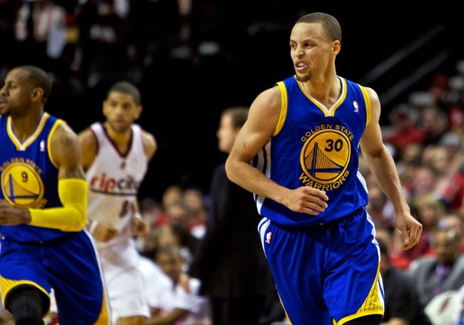 Apr 13, 2014; Portland, OR, USA; Golden State Warriors guard Stephen Curry (30) reacts after making a basket against the Portland Trail Blazers during the fourth quarter at the Moda Center. Mandatory Credit: Craig Mitchelldyer-USA TODAY Sports