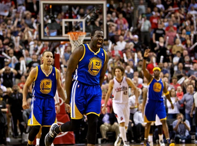 Apr 13, 2014; Portland, OR, USA; Golden State Warriors forward Draymond Green (23) reacts making a basket at the end of regulation against the Portland Trail Blazers at the Moda Center. Mandatory Credit: Craig Mitchelldyer-USA TODAY Sports