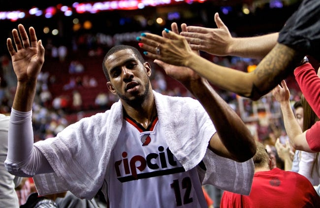Apr 13, 2014; Portland, OR, USA; Portland Trail Blazers forward LaMarcus Aldridge (12) walks off the court after beating the Golden State Warriors at the Moda Center. Mandatory Credit: Craig Mitchelldyer-USA TODAY Sports