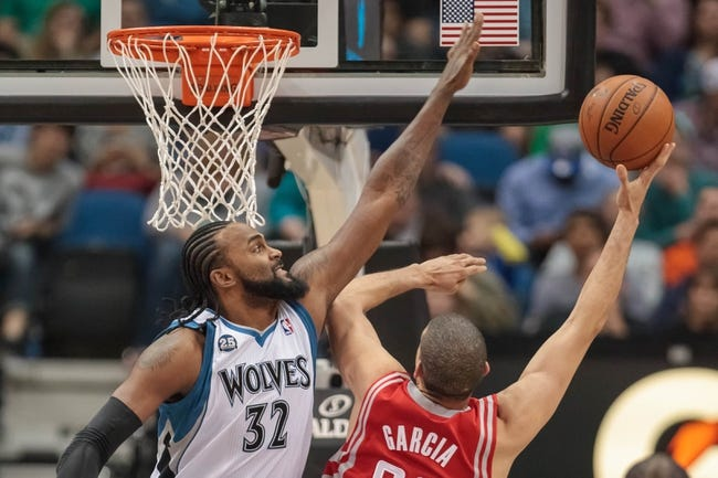 Apr 11, 2014; Minneapolis, MN, USA; Minnesota Timberwolves center Ronny Turiaf (32) blocks Houston Rockets guard Francisco Garcia (32) at Target Center. The Minnesota Timberwolves win 112-110. Mandatory Credit: Brad Rempel-USA TODAY Sports