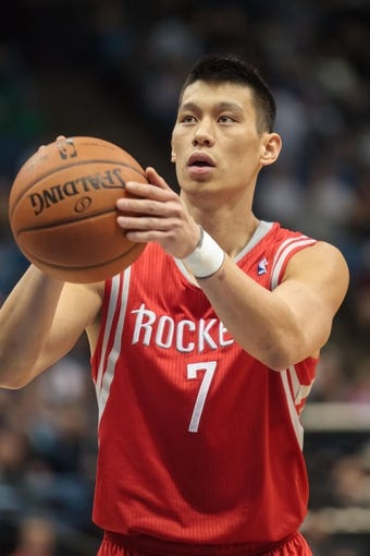 Apr 11, 2014; Minneapolis, MN, USA; Houston Rockets guard Jeremy Lin (7) shoots at Target Center. The Minnesota Timberwolves win 112-110. Mandatory Credit: Brad Rempel-USA TODAY Sports