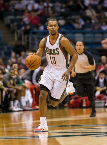 Apr 5, 2014; Milwaukee, WI, USA; Milwaukee Bucks guard Ramon Sessions (13) during the game against the Toronto Raptors at BMO Harris Bradley Center.  Toronto won 102-98.  Mandatory Credit: Jeff Hanisch-USA TODAY Sports